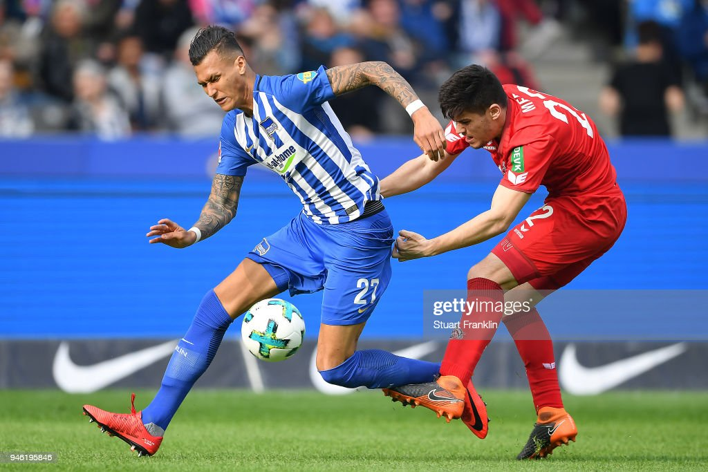 Davie Selke of Berlin (l) fights for the ball with Jorge Mere of Koeln during the Bundesliga match between Hertha BSC and 1. FC Koeln at Olympiastadion on April 14, 2018 in Berlin, Germany.