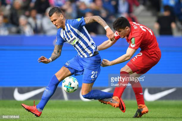 Davie Selke of Berlin fights for the ball with Jorge Mere of Koeln during the Bundesliga match between Hertha BSC and 1 FC Koeln at Olympiastadion on...