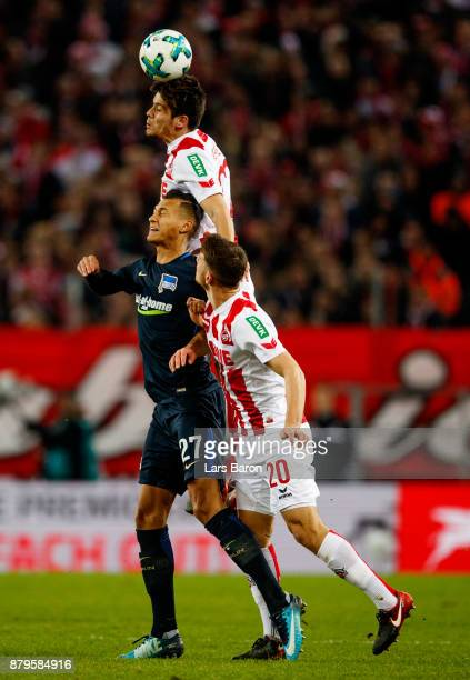 Davie Selke of Berlin goes up for a header with Jorge Mere of Koeln and Salih Oezcan of Koeln during the Bundesliga match between 1 FC Koeln and...