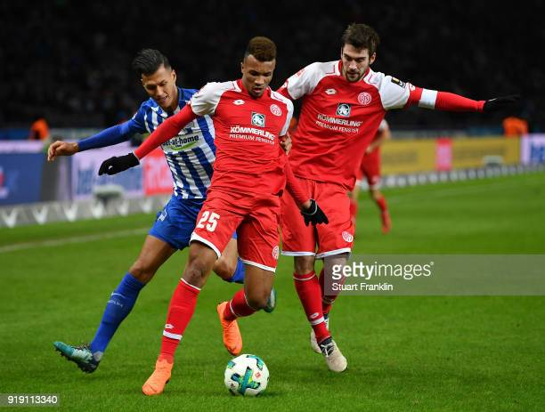 Davie Selke of Berlin is challenged by JeanPhilippe Gbamin of Mainz during the Bundesliga match between Hertha BSC and 1 FSV Mainz 05 at...