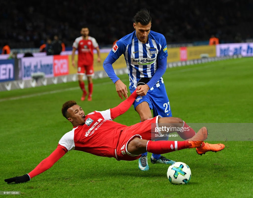Davie Selke of Berlin is challenged by Jean-Philippe Gbamin of Mainz during the Bundesliga match between Hertha BSC and 1. FSV Mainz 05 at Olympiastadion on February 16, 2018 in Berlin, Germany.