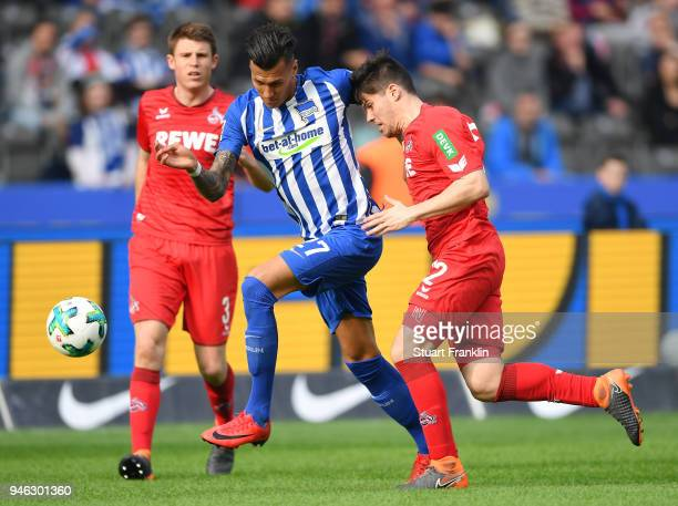 Davie Selke of Berlin is challenged by Jorge MerŽÊ of Cologne during the Bundesliga match between Hertha BSC and 1 FC Koeln at Olympiastadion on...