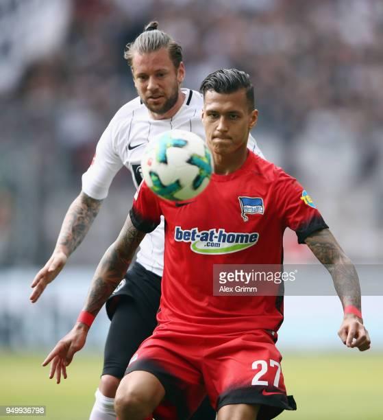 Davie Selke of Berlin is challenged by Marco Russ of Frankfurt during the Bundesliga match between Eintracht Frankfurt and Hertha BSC at...