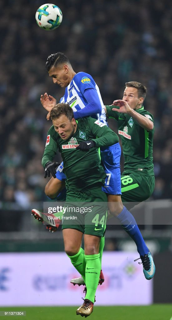 Davie Selke of Berlin is challenged by Philipp Bargfrede and Niklas Moisander of Bremen during the Bundesliga match between SV Werder Bremen and Hertha BSC at Weserstadion on January 27, 2018 in Bremen, Germany.