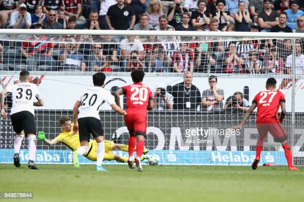 Davie Selke of Berlin scores his team's first goal with a penalty against goalkeeper Lukas Hradecky of Frankfurt during the Bundesliga match between...