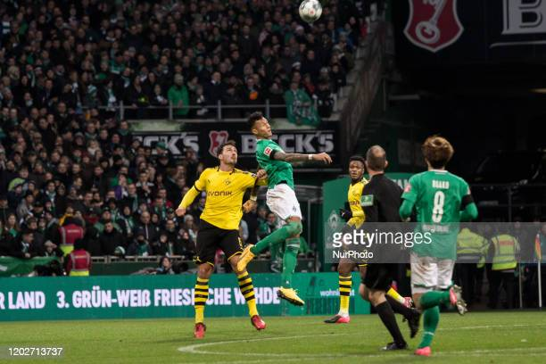Davie Selke of Bremen battle for the ball against Mats Hummels of Dortmund during the 1 Bundesliga match SV Werder Bremen v Borussia Dortmund in...