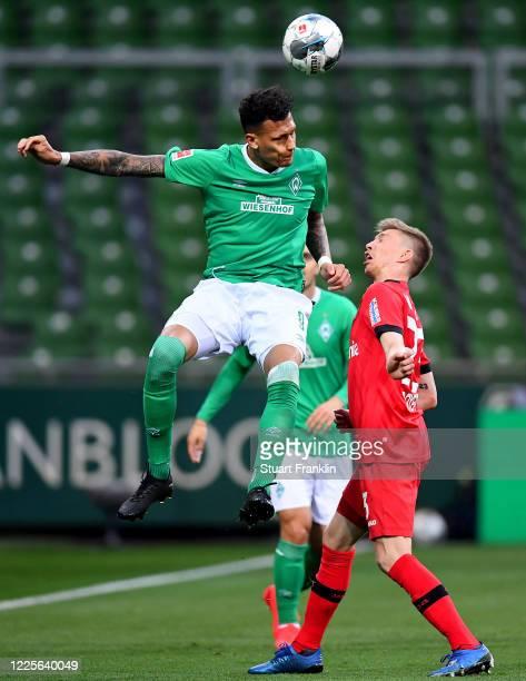 Davie Selke of Bremen challenges Mitchell Weiser of Leverkusen during the Bundesliga match between SV Werder Bremen and Bayer 04 Leverkusen at...