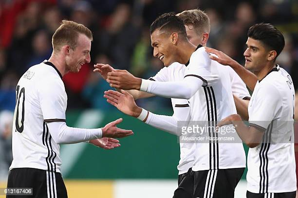 Davie Selke of Germany celebrates scoring the 3rd team goal with his team mates Maximilian Arnold during the 2017 UEFA European U21 Championships...