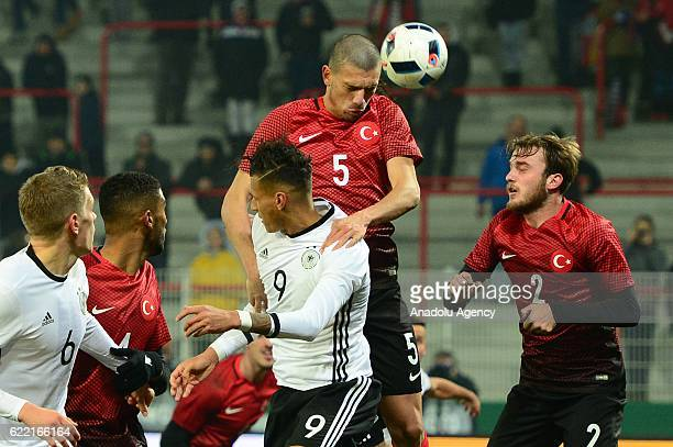 Davie Selke of Germany in action against Merih Demiral of Turkey during a U21 international soccer match between Germany and Turkey in Berlin Germany...