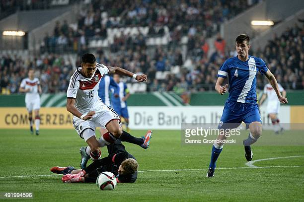 Davie Selke of Germany is brought down by Otso Virtanen of Finland during the 2017 UEFA European U21 Championships Qualifier between U21 Germany and...