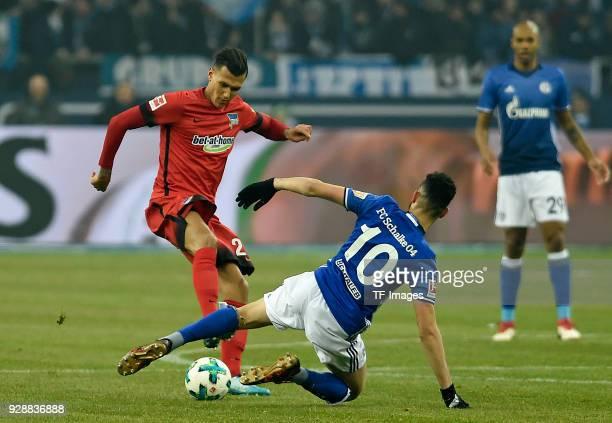 Davie Selke of Hertha and Nabil Bentaleb of Schalke battle for the ball during the Bundesliga match between FC Schalke 04 and Hertha BSC at...