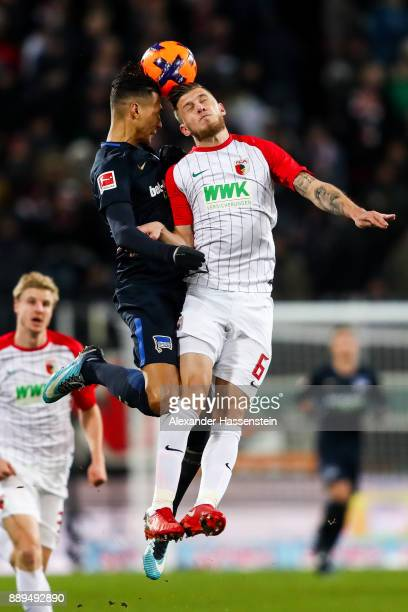 Davie Selke of Hertha Berlin and Jeffrey Gouweleeuw of Augsburg battle for the ball during the Bundesliga match between FC Augsburg and Hertha BSC at...
