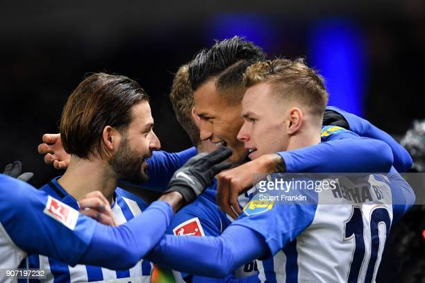 Davie Selke of Hertha Berlin celebrates with his teammates after scoring his team's first goal to make it 10 during the Bundesliga match between...