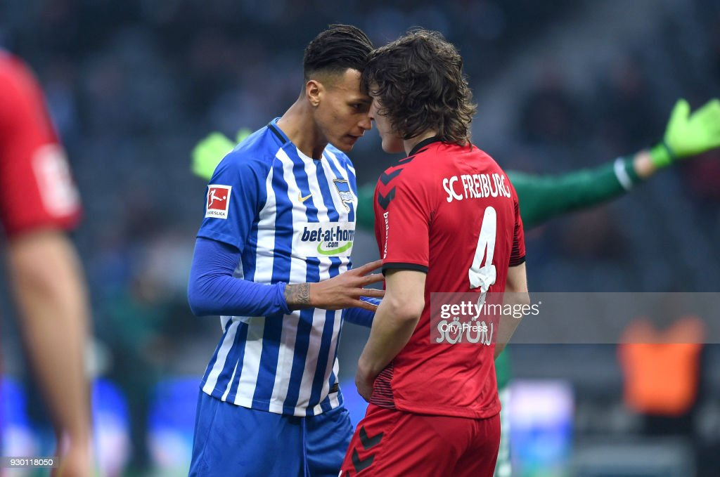 Davie Selke of Hertha BSC and Caglar Soeyuencue of SC Freiburg during the Bundesliga match between Hertha BSC and SC Freiburg at Olympiastadion on March 10, 2018 in Berlin, Germany.