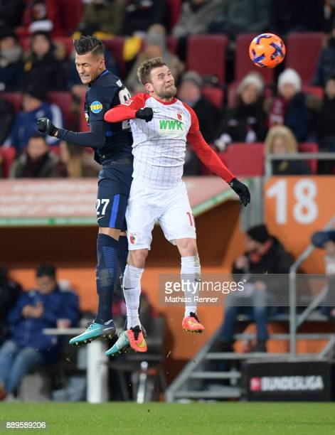 Davie Selke of Hertha BSC and Daniel Baier of FC Augsburg during the game between dem FC Augsburg and Hertha BSC on december 10 2017 in Augsburg...