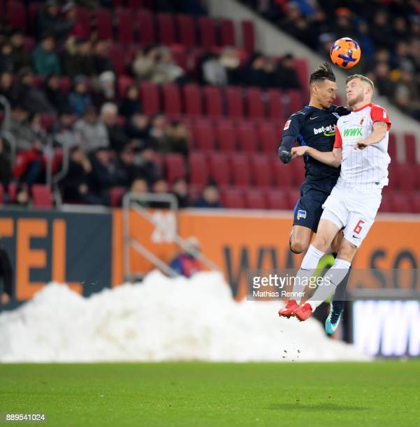 Davie Selke of Hertha BSC and Jeffrey Gouweleeuw of FC Augsburg during the Bundesliga match between FC Augsburg and Hertha BSC on December 10 2017 in...
