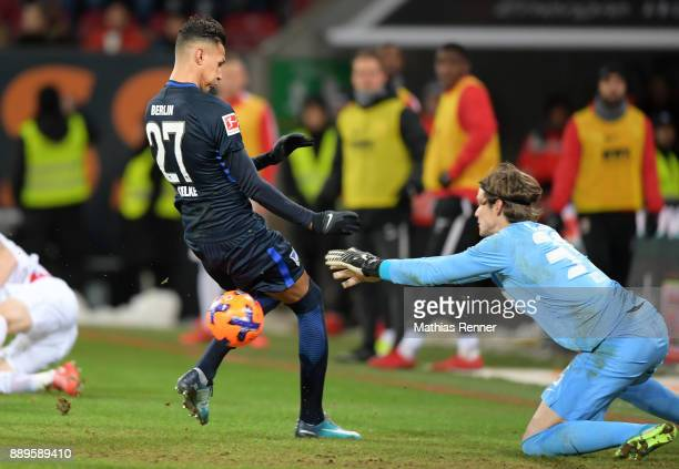 Davie Selke of Hertha BSC and Marwin Hitz of FC Augsburg during the game between dem FC Augsburg and Hertha BSC on december 10 2017 in Augsburg...