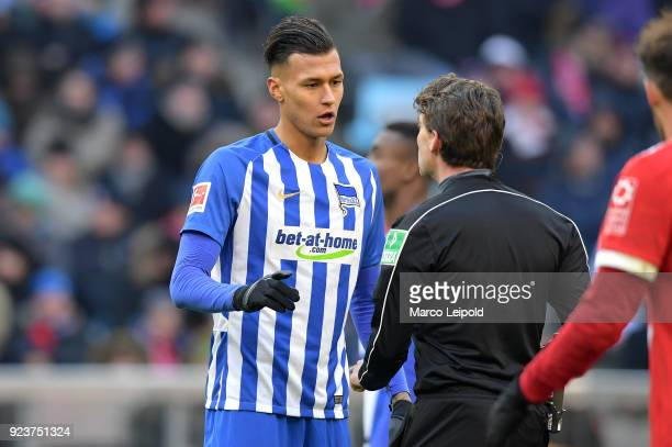 Davie Selke of Hertha BSC and referee Guido Winkmann during the Bundesliga match between FC Bayern Muenchen and Hertha BSC at the Allianz Arena on...