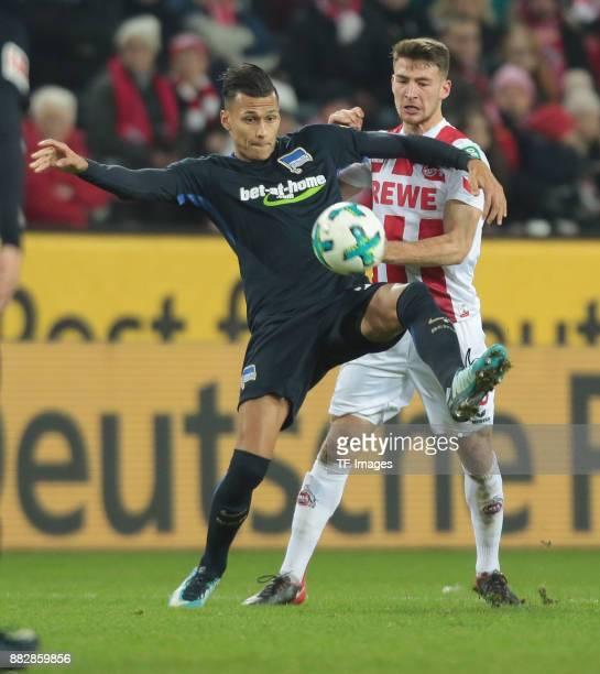 Davie Selke of Hertha BSC Berlin and Salih Oezcan of Koeln battle for the ball during the Bundesliga match between 1 FC Koeln and Hertha BSC at...