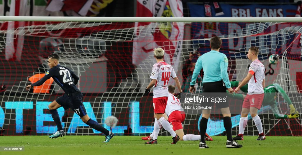 Davie Selke of Hertha BSC celebrates after scoring his team's first goal against goalkeeper Peter Gulacsi of RB Leipzig during the Bundesliga match between RB Leipzig and Hertha BSC at Red Bull Arena on December 17, 2017 in Leipzig, Germany.