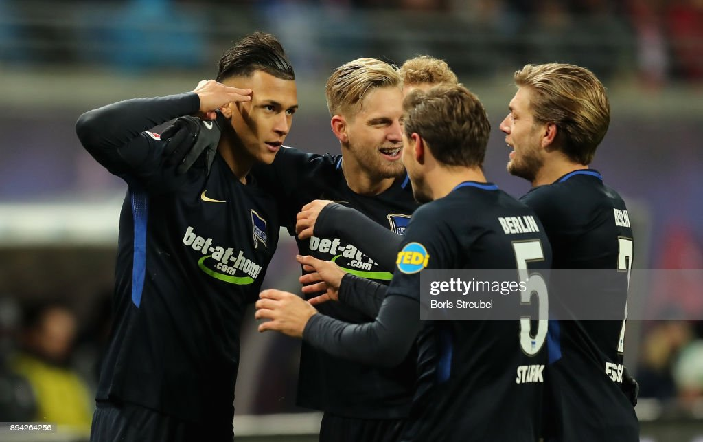 Davie Selke of Hertha BSC celebrates with team mates after scoring his team's third goal during the Bundesliga match between RB Leipzig and Hertha BSC at Red Bull Arena on December 17, 2017 in Leipzig, Germany.