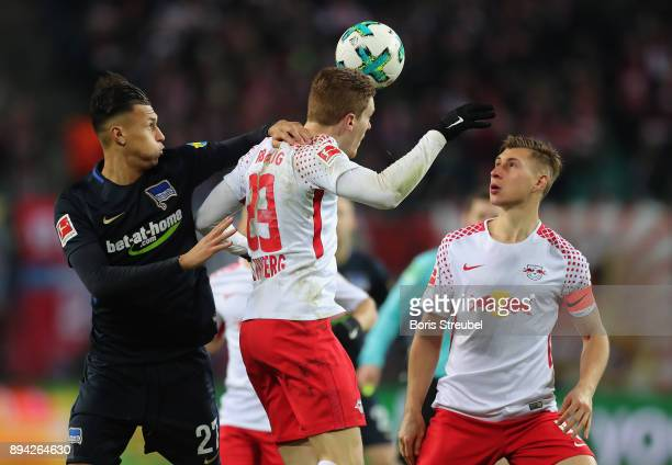 Davie Selke of Hertha BSC is challenged by Marcel Halstenberg and Willi Orban of RB Leipzig during the Bundesliga match between RB Leipzig and Hertha...