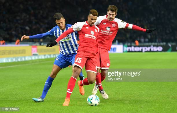 Davie Selke of Hertha BSC JeanPhilippe Gbamin and Stefan Bell of FSV Mainz 05 during the first Bundesliga game between Hertha BSC and 1st FSV Mainz...
