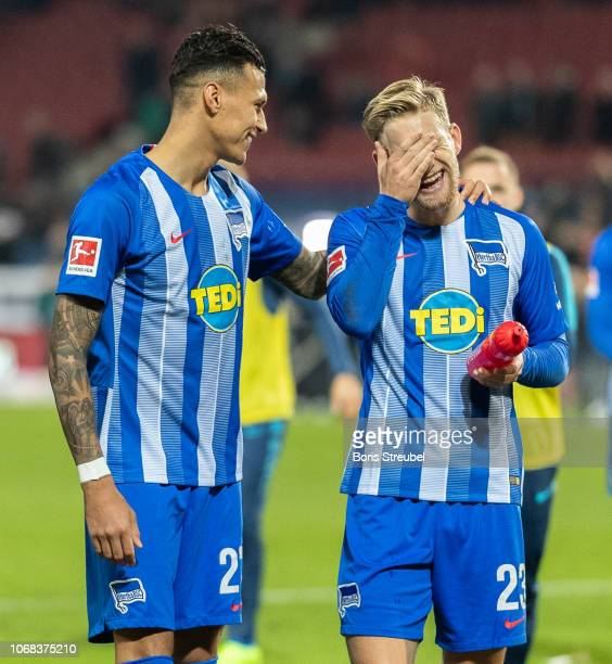 Davie Selke of Hertha BSC jokes around with Arne Maier of Hertha BSC after the Bundesliga match between Hannover 96 and Hertha BSC at HDIArena on...