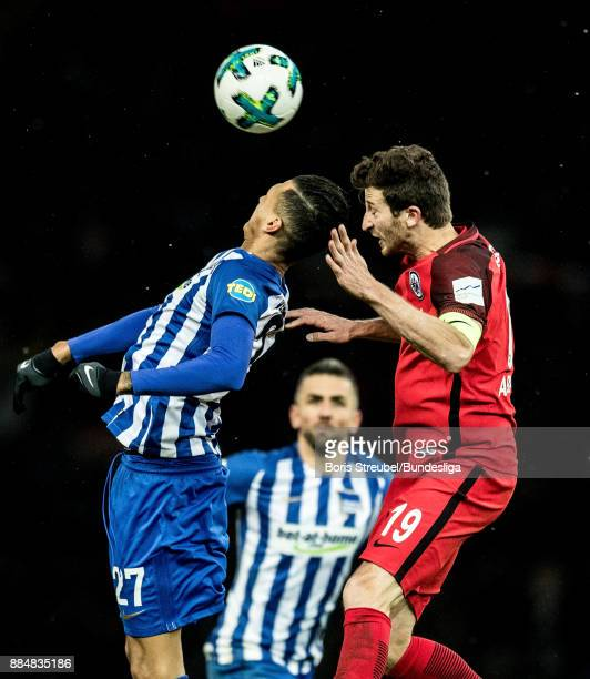 Davie Selke of Hertha BSC jumps for a header with David Angel Abraham of Eintracht Frankfurt during the Bundesliga match between Hertha BSC and...