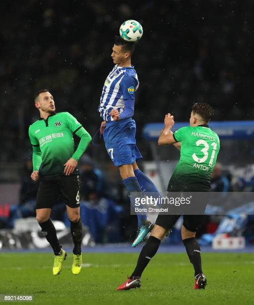 Davie Selke of Hertha BSC jumps for a header with Marvin Bakalorz of Hannover 96 and Waldemar Anton of Hannover 96 during the Bundesliga match...