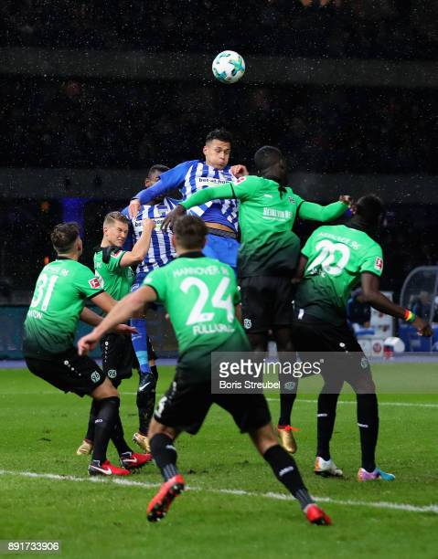 Davie Selke of Hertha BSC jumps for a header with players of Hannover 96 during the Bundesliga match between Hertha BSC and Hannover 96 at...