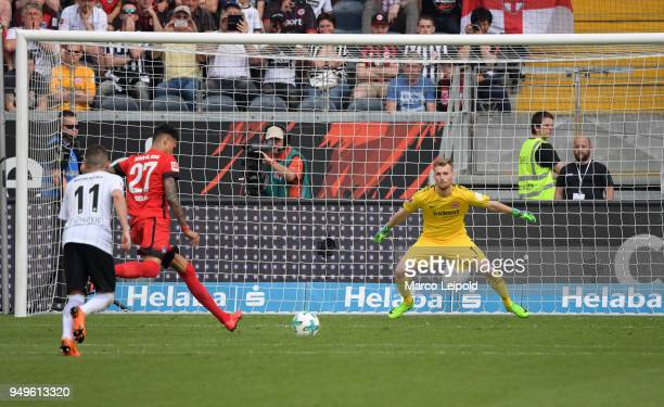 Davie Selke of Hertha BSC scores the 01 against Lukas Hradecky of Eintracht Frankfurt during the match between Eintracht Frankfurt and Hertha BSC at...