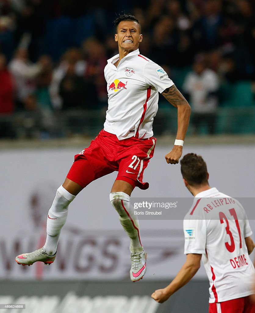 Davie Selke (L) of Leipzig celebrates his team's first goal with team mate Diego Demme during the Second Bundesliga match between RB Leipzig and SC Freiburg at Red Bull Arena on September 24, 2015 in Leipzig, Germany.