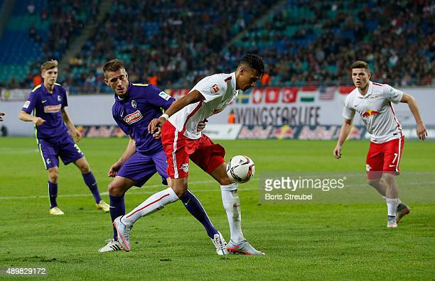 Davie Selke of Leipzig is challenged by Nils Petersen of Freiburg during the Second Bundesliga match between RB Leipzig and SC Freiburg at Red Bull...
