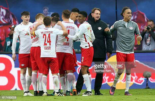 Davie Selke of Leipzig jubilates with team mates and head coach Ralph Hasenhuettl after scoring the fourth goal during the Bundesliga match between...