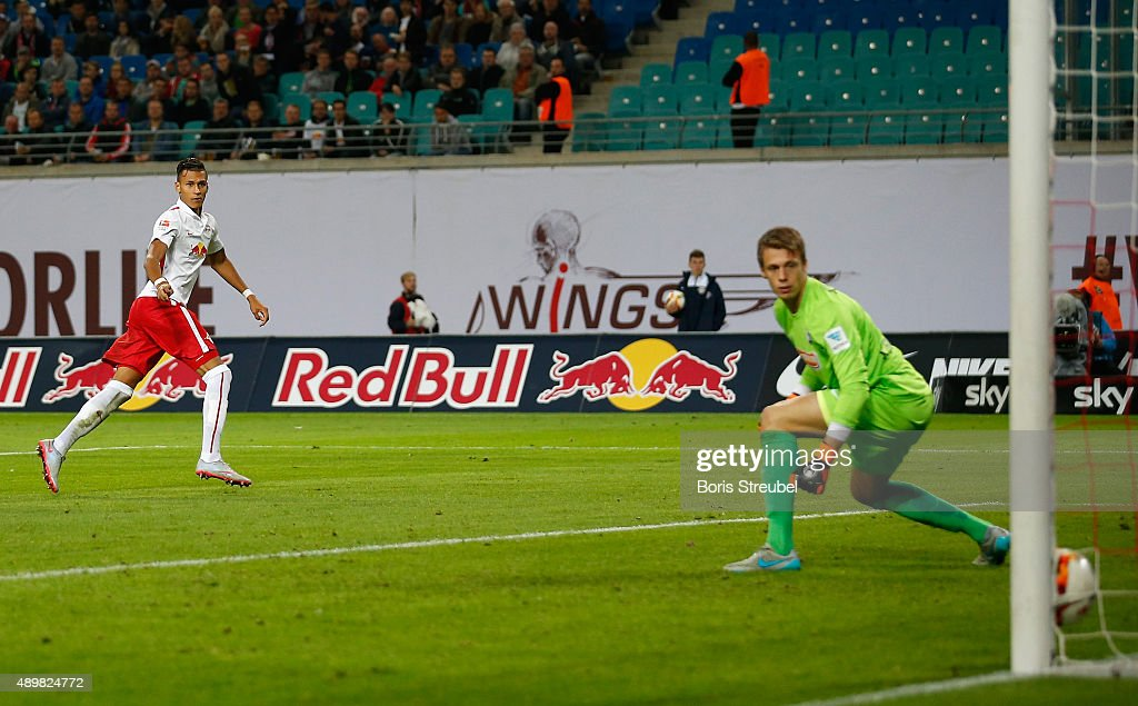 Davie Selke (L) of Leipzig scores his team's first goal against goalkeeper Alexander Schwolow of Freiburg during the Second Bundesliga match between RB Leipzig and SC Freiburg at Red Bull Arena on September 24, 2015 in Leipzig, Germany.
