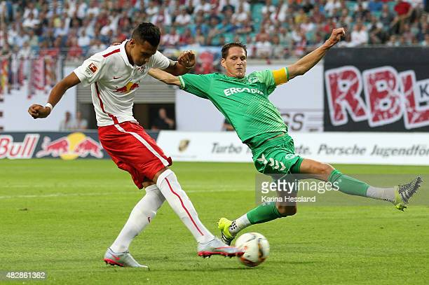 Davie Selke of Leipzig scores the second goal Benedikt Roecker of Fuerth cant stop him during the Second Bundesliga match between RB Leipzig and...