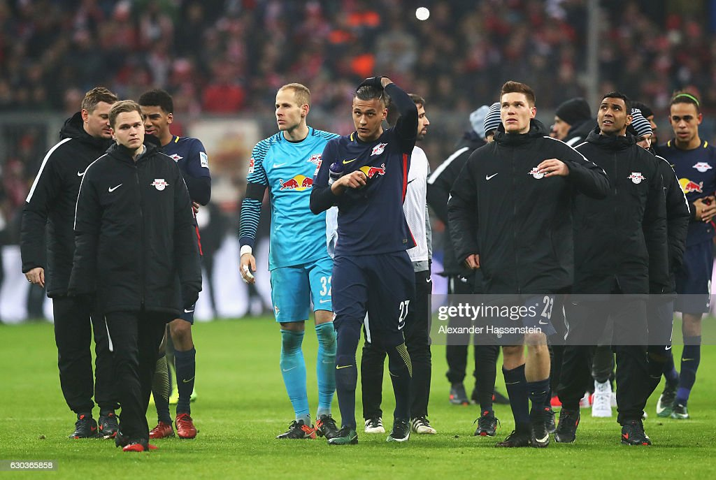 Davie Selke of RB Leipzig (C) and his RB Leipzig team mates look dejected after the final whistle during the Bundesliga match between Bayern Muenchen and RB Leipzig at Allianz Arena on December 21, 2016 in Munich, Germany.