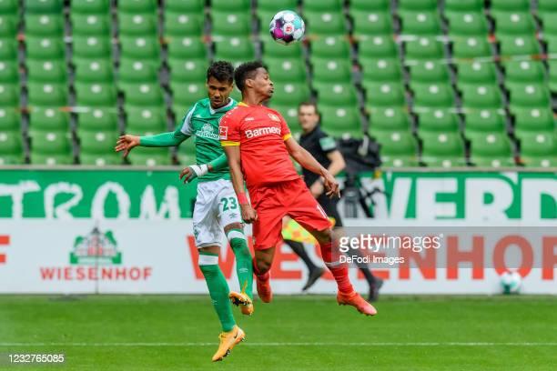 Davie Selke of SV Werder Bremen and Edmond Tapsoba of Bayer 04 Leverkusen battle for the ball during the Bundesliga match between SV Werder Bremen...