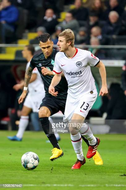 Davie Selke of SV Werder Bremen and Martin Hinteregger of Eintracht Frankfurt during the DFB Cup quarterfinal match between Eintracht Frankfurt and...