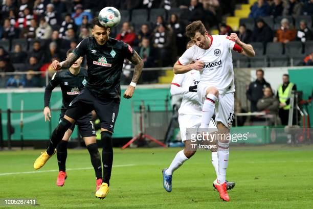 Davie Selke of SV Werder Bremen David Abraham of Eintracht Frankfurt during the DFB Cup quarterfinal match between Eintracht Frankfurt and Werder...