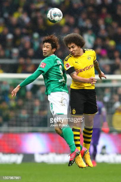 Davie Selke of SV Werder Bremen jumps with Axel Witsel of Borussia Dortmund during the Bundesliga match between SV Werder Bremen and Borussia...