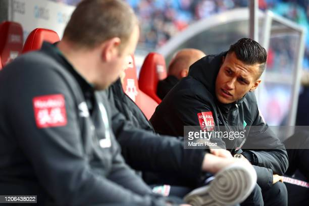 Davie Selke of SV Werder Bremen looks on from the bench prior to the Bundesliga match between RB Leipzig and SV Werder Bremen at Red Bull Arena on...