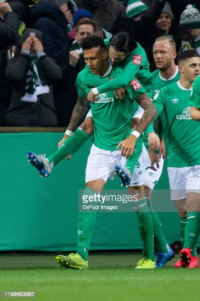 Davie Selke of SV Werder Bremen with Leonardo Bittencourtof SV Werder Bremen celebrates after scoring his team's first goal during the DFB Cup round...