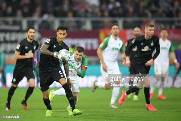 Davie Selke of Werder Bremen and Daniel Baier of FC Augsburg run after the ball during the Bundesliga match between FC Augsburg and SV Werder Bremen...