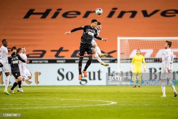 Davie Selke of Werder Bremen and Matthias Ginter of Borussia Moenchengladbach battle for the ball during the Bundesliga match between Borussia...