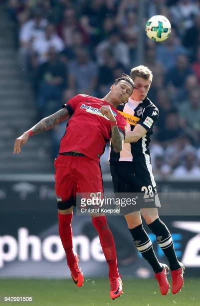 Davie Selkie of Berlin and Matthias Ginter of Moenchengladbach go up for a header during the Bundesliga match between Borussia Moenchengladbach and...