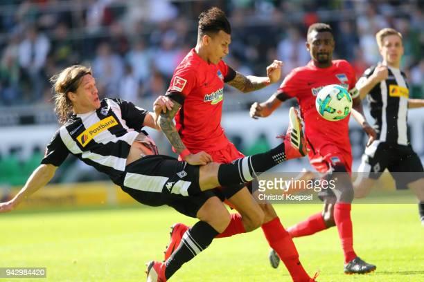 Davie Selkie of Berlin scores the first goal against Jannik Vestergaard of Moenchengladbach during the Bundesliga match between Borussia...