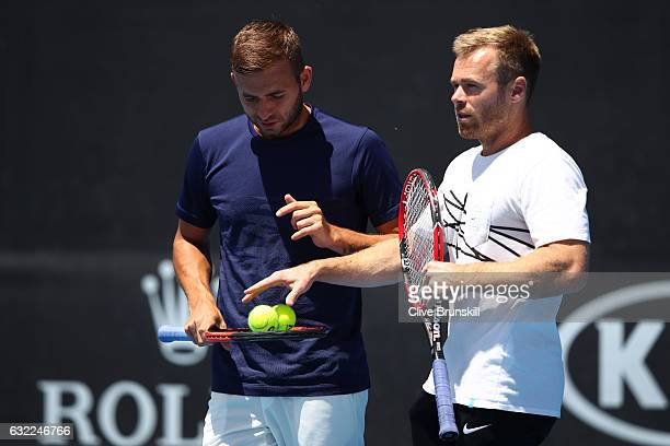 Daviel Evans of Great Britain and his coach Mark Hilton during a practice session on day six of the 2017 Australian Open at Melbourne Park on January...
