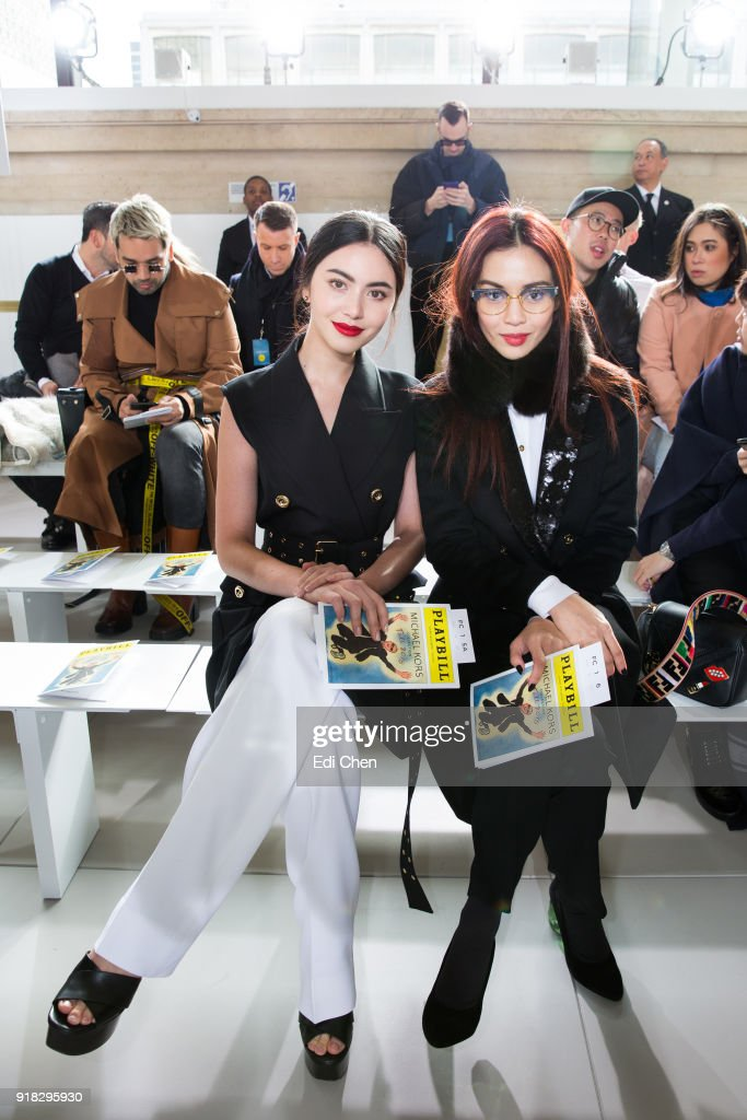 Davika Hoorne (L) and Duang Poshyanonda attends the Michael Kors Collection Fall 2018 Runway Show at the Vivian Beaumont Theatre on February 14, 2018 in New York City.